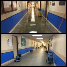 Before and after - Hallway flooded with several inches of water the hallway shown with drying equipment, 24 hour restoration in Tampa, FL 33602